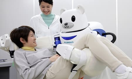 Robot Nurses & Sitters | Robear is able to transfer weak patients from a wheelchair to a bed or bathroom.
